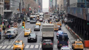 In this Thursday, Jan. 11, 2018 photo, traffic is seen making it's way across 42nd Street in New York. A proposal to make part Manhattan a toll zone, where drivers would be charged to drive into the most congested neighborhoods, is gaining momentum, despite continuing criticism from lawmakers representing car-heavy parts of Brooklyn and Queens. (AP Photo/Mary Altaffer)