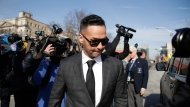 "Michael ""The Situation"" Sorrentino, one of the former stars of the ""Jersey Shore"" reality TV show, is swarmed by reporters while leaving the Martin Luther King, Jr., Federal Courthouse after a hearing, Friday, Jan. 19, 2018, in Newark, N.J. Sorrentino pleaded guilty to one count of tax evasion and admitted concealing his income in 2011 by making cash deposits in amounts that wouldn't trigger federal reporting requirements. He and his brother, Marc, were charged in 2014 and again last year with multiple counts related to nearly $9 million in income from the show. (AP Photo/Julio Cortez)"
