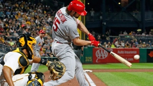 St. Louis Cardinals' Randal Grichuk (15) drives in two runs with a double off Pittsburgh Pirates starting pitcher Gerrit Cole in the sixth inning of a baseball game, Saturday, Sept. 23, 2017 in Pittsburgh. (AP Photo/Gene J. Puskar)