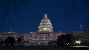 With no apparent indications of a breakthrough in the Senate to avoid a government shutdown, the Capitol is illuminated in Washington, Friday evening, Jan. 19, 2018. (AP Photo/J. Scott Applewhite)
