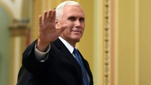 In this Jan. 3, 2018, file photo, Vice President Mike Pence waves as he walks on Capitol Hill in Washington. (AP Photo/Susan Walsh, File)