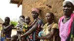 In this Wednesday Oct. 4, 2017, file photo, women and children of Terekeka, South Sudan. A new report says the world is moving closer to eradicating Guinea worm disease, in which a meter-long worm slowly emerges from a blister in a person's skin.(AP Photo/Mariah Quesada, File)