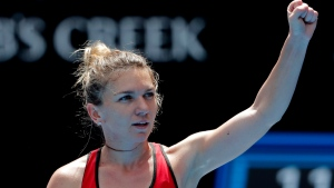 Romania's Simona Halep celebrates after defeating United States' Lauren Davis in their third round match at the Australian Open tennis championships in Melbourne, Australia, Saturday, Jan. 20, 2018. (AP Photo/Vincent Thian