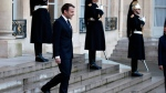 France's President Emmanuel Macron walks down stairs to welcome German Chancellor Angela Merkel, prior to a meeting, at the Elysee Palace, in Paris, Friday, Jan. 19, 2018. (AP Photo/Thibault Camus)
