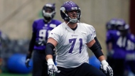 Minnesota Vikings tackle Riley Reiff stretches during practice Friday, Jan. 19, 2018, in Eden Prairie, Minn., in preparation for the upcoming NFC Championship football game against the Eagles in Philadelphia. (AP Photo/Jim Mone)