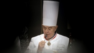 "In this Jan. 29 2013 file photo, French chef Paul Bocuse tastes a dish during the ""Bocuse d'Or"" (Golden Bocuse) trophy, at the 14th World Cuisine contest, in Lyon, central France. French interior minister announces Saturday Jan.20, 2018 that Paul Bocuse, a master of French cuisine, has died at 91. (AP Photo/Laurent Cipriani, File)"