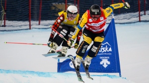 Sweden's Sandra Naeslund, right, and Canada's Kelsey Serwa ski during the women's semifinal at the World Cup ski cross event at Nakiska Ski resort in Kananaskis, Alta., Saturday, Jan. 20, 2018.THE CANADIAN PRESS/Jeff McIntosh