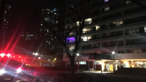 A fire truck is seen outside 30 Gloucester Street after a man injured himself in a cooking mishap. (Leena Latafat/CP24)