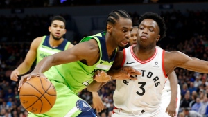 Minnesota Timberwolves' Andrew Wiggins, left, drives around Toronto Raptors' OG Anunoby, of England, in the first half of an NBA basketball game Saturday, Jan. 20, 2018, in Minneapolis. (AP Photo/Jim Mone)