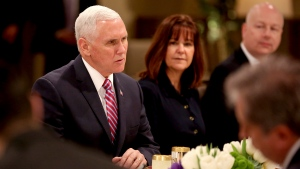 U.S. Vice President Mike Pence and his wife Karen Pence, attend a lunch hosted by Jordan's King Abdullah II at the Husseiniyeh Palace in Amman, Jordan, Sunday, Jan. 21, 2018. (AP Photo/Raad Adayleh)