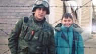 Justin Frye, left, poses with Amir Bagramovic, a Bosnian child he met while stationed in the war-torn country with the United Nations in 1994 in this handout photo. A Canadian veteran of the Bosnian war who reconnected with a local boy he met during the conflict says meeting him again and finding out he's doing well two decades later has been one of the best experiences of his life. THE CANADIAN PRESS/HO, Justin Frye