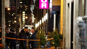Police investigate a shooting Sunday, Jan. 21, 2018, in midtown Manhattan in New York where, police say,three people were shot blocks from Penn Station and Macy's Herald Square store. The victims' wounds are not considered life-threatening and no arrests have been made. (AP Photo/Kathy Willens)