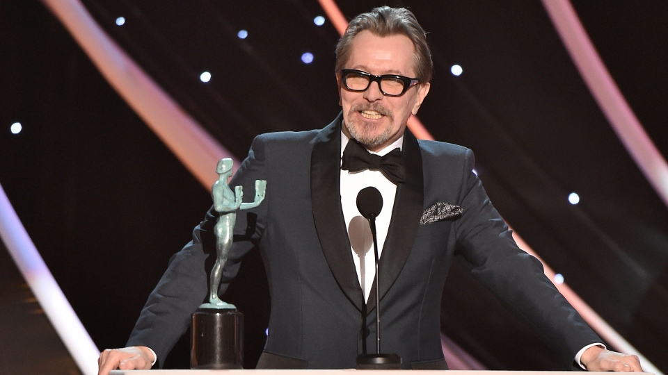 "Gary Oldman accepts the award for outstanding performance by a male actor in a leading role for ""Darkest Hour"" at the 24th annual Screen Actors Guild Awards at the Shrine Auditorium & Expo Hall on Sunday, Jan. 21, 2018, in Los Angeles. (Photo by Vince Bucci/Invision/AP)"