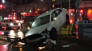 Police say a driver was taken to hospital after crashing his car into a TTC stop downtown. (Mike Nguyen/ CP24)
