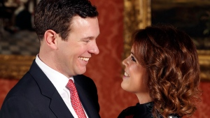Britain's Princess Eugenie and Jack Brooksbank pose for the media in the Picture Gallery at Buckingham Palace after they announced their engagement in London, Monday, Jan. 22, 2018. Princess Eugenie is engaged to be married later this year, several months after her cousin Prince Harry's nuptials. Eugenie, the daughter of Prince Andrew and his ex-wife Sarah Ferguson, will marry Jack Brooksbank in the fall, Buckingham Palace said Monday. (Jonathan Brady/Pool Photo via AP)