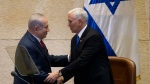 Israel's Prime Minister Benjamin Netanyahu, left, shake hands with U.S. Vice President Mike Pence in Israel's parliament in Jerusalem, Monday, Jan. 22, 2018. (AP Photo/Ariel Schalit, Pool)