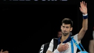 Serbia's Novak Djokovic waves as he leaves Rod Laver Arena after losing to South Korea's Chung Hyeon during their fourth round match at the Australian Open tennis championships in Melbourne, Australia, Monday, Jan. 22, 2018. (AP Photo/Dita Alangkara)