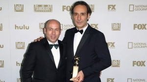 """J. Miles Dale, left, poses with Alexandre Desplat, winner of the award for best original score - motion picture for """"The Shape of Water"""" at the FOX Golden Globes afterparty at the Beverly Hilton Hotel on Sunday, Jan. 7, 2018, in Beverly Hills, Calif. (Photo by Willy Sanjuan/Invision/AP)"""