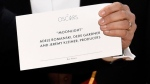 "Jordan Horowitz holds up the envelope that reveals ""Moonlight"" as the winner of the award for best picture at the Oscars on Sunday, Feb. 26, 2017, at the Dolby Theatre in Los Angeles. (Photo by Chris Pizzello/Invision/AP)"
