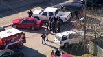 This photo from video by KDFW Fox4 shows law enforcement personnel gathered outside a high school in Italy, Texas, following an active shooter incident at the school Monday morning, Jan. 22, 2018. Sheriff's officials said a boy who is a student at the school was taken into custody. (KDFW Fox4 via AP)
