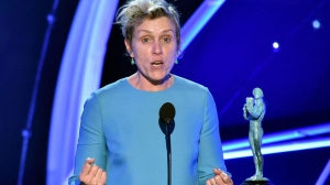 "Frances McDormand accepts the award for outstanding performance by a female actor in a leading role for ""Three Billboards Outside Ebbing, Missouri"" at the 24th annual Screen Actors Guild Awards at the Shrine Auditorium & Expo Hall on Sunday, Jan. 21, 2018, in Los Angeles. (Photo by Vince Bucci/Invision/AP)"