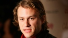 "In this Nov. 6, 2006, file photo, actor Heath Ledger arrives to the premiere of his new film ""Candy"" in New York. The music video Ledger directed for ""King Rat"" by Modest Mouse debuted online Tuesday Aug. 4, 2009. The six-minute, animated video is both whimsical and dark, showing whales and dolphins aboard a ship, fishing for humans in the water. (AP Photo/Dima Gavrysh, File)"