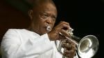 FILE - In an April 29, 2006 file photo, Hugh Masekela performs during the 2006 New Orleans Jazz and Heritage Festival in New Orleans. A family statement issued on Twitter Tuesday Jan. 23, 2018, says South African jazz musician and anti-apartheid activist Hugh Masekela, 78, passed away in Johannesburg after a lengthy battle against prostate cancer. (AP Photo/Jeff Christensen, File)