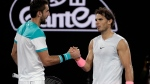 Spain's Rafael Nadal, right, shakes the hand of Croatia's Marin Cilic after retiring injured from their quarterfinal at the Australian Open tennis championships in Melbourne, Australia, Tuesday, Jan. 23, 2018. (AP Photo/Dita Alangkara)