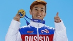 In this Feb. 15, 2014, file photo, men's 1,000-meter short track speedskating gold medalist Viktor Ahn, of Russia, gestures while holding his medal during the medals ceremony at the Winter Olympics in Sochi, Russia. The Russian Olympic Committee says Ahn, a six-time Olympic gold medalist, is among several top Russian athletes barred from the upcoming Pyeongchang Olympics amid the country's ongoing doping scandal. (AP Photo/David J. Phillip, File)