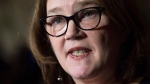 Indigenous Services Minister Jane Philpott speaks with reporters in the Foyer of the House of Commons before Question Period Thursday Nov.30, 2017 in Ottawa. THE CANADIAN PRESS/Adrian Wyld