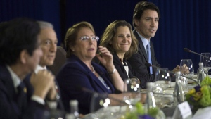 Prime Minister Justin Trudeau, right, sits beside Minister of International Trade Chrystia Freehand as they take part in a Trans-Pacific Partnership meeting on the side-lines of the APEC Summit in Manila, Philippines on Wednesday, November 18, 2015. Canada and the remaining members of the Trans-Pacific Partnership have agreed to a revised trade agreement, according to several international media reports early Tuesday. THE CANADIAN PRESS/Sean Kilpatrick