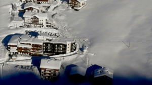 An aerial view of the Langtauferer hotel in the Venosta valley, northern Italy, Tuesday, Jan. 23, 2018. About 75 tourists and hotel workers were being evacuated from a four-star mountainside hotel in northern Italy near the Austrian border after an avalanche overnight, the hotel manager said Tuesday as heavy snow caused disruption across the Alps. The Langtauferer Hotel, located near the Austrian border at 1,870 meters (6,135 feet) above sea level and some 100 kilometers (about 60 kilometers) northwest of Bolzano, was not directly hit, but was in an area of extremely high risk for further avalanches. (Italian Army via AP)