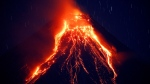 Lava cascades down the slopes of Mayon volcano during its eruption for the second straight day Tuesday, Jan. 23, 2018 as seen from Legazpi city, Albay province, southeast of Manila, Philippines. (AP Photo/Bullit Marquez)