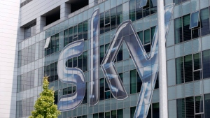 This Friday, July 25, 2014, file photo shows a view of the headquarters of the Italian Sky television broadcaster in Milan, Italy. Disney announced Thursday, Dec. 14, 2017, that it is buying a large part of Fox. Under the deal, Disney will get at least a 39 percent stake in European satellite-TV and broadcaster Sky. Fox is hoping to acquire the remainder of Sky before the deal closes, giving Disney full control. (AP Photo/Luca Bruno, File)