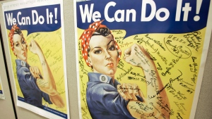 In this Oct. 31, 2007 file photo, a poster showing signatures of former Rosie the Riveter's is seen at the offices of the Rosie the Riveter/World War II Home Front National Historic Park in Richmond, Calif. A woman identified by a scholar as the inspiration for Rosie the Riveter, the iconic female World War II factory worker, has died in Washington state. The New York Times reports that Naomi Parker Fraley died Saturday, Jan. 20, 2018, in Longview. She was 96. Multiple women have been identified over the years as possible models for Rosie, but a Seton Hall University professor in 2016 focused on Fraley as the true inspiration. (AP Photo/Eric Risberg, File)