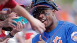 New York Mets' Curtis Granderson poses for photos and signs autographs for fans before a spring training baseball game against the St. Louis Cardinals Tuesday, March 28, 2017, in Port St. Lucie, Fla. (AP Photo/John Bazemore)
