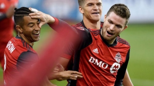 Toronto FC forward Eriq Zavaleta (15) celebrates his goal with teammates Justin Morrow (2) and Nick Hagglund (6) during first half MLS soccer action against the Chicago Fire, in Toronto on Friday, April 21, 2017. THE CANADIAN PRESS/Frank Gunn