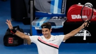Switzerland's Roger Federer celebrates after defeating Tomas Berdych of the Czech Republic in their quarterfinal at the Australian Open tennis championships in Melbourne, Australia, Wednesday, Jan. 24, 2018. (AP Photo/Ng Han Guan)