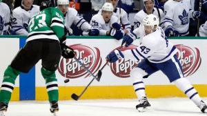 Dallas Stars defenseman Esa Lindell (23) of Finland and Toronto Maple Leafs center Nazem Kadri (43) compete for control of an airborne puck in the third period of an NHL hockey game Thursday, Jan. 25, 2018, in Dallas. (AP Photo/Tony Gutierrez)