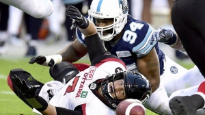 Ottawa Redblacks quarterback Trevor Harris (7) fumbles the ball as Toronto Argonauts defensive end Victor Butler (94) completes the tackle during first half CFL action in Toronto on July 24, 2017. Defensive linemen Victor Butler and Cleyon Laing are back in the Toronto Argonauts' lineup. After stints on the six-game injured list, both players will suit up Saturday when Toronto hosts the Edmonton Eskimos. THE CANADIAN PRESS/Frank Gunn