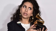 Alessia Cara poses in the press room with the best new artist award at the 60th annual Grammy Awards at Madison Square Garden on Sunday, Jan. 28, 2018, in New York. (Photo by Charles Sykes/Invision/AP)