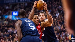 Toronto Raptors guard DeMar DeRozan (10) moves past Minnesota Timberwolves Gorgui Dieng (left) during first half NBA basketball action in Toronto on Tuesday, Jan. 30, 2018. THE CANADIAN PRESS/Christopher Katsarov