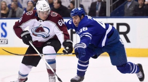 Colorado Avalanche right wing Nail Yakupov (64) plays the puck in the offensive zone as Toronto Maple Leafs defenceman Roman Polak (46) defends during first period NHL hockey action in Toronto on Monday, January 22, 2018. THE CANADIAN PRESS/Nathan Denette