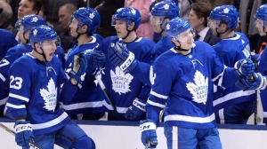 Toronto Maple Leafs defenceman Justin Holl (right) celebrates his first career goal in his first NHL game with teammate Travis Dermott (23) against the New York Islanders during third period NHL hockey action in Toronto on Wednesday, January 31, 2018. THE CANADIAN PRESS/Frank Gunn