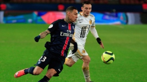 PSG's Gregory van der Wiel, left, challenges for the ball with Lille's Eric Bautheac, during their League One soccer match, at the Parc des Princes stadium, in Paris, Saturday, Feb. 13, 2016. It appears Toronto FC has found one of its international targets.Dutch international Gregory van der Wiel was courtside at the Raptors' game against the Los Angeles Lakers on Sunday. THE CANADIAN PRESS/AP, Thibault Camus