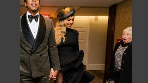 A woman looks on as Beyonce and Jay-Z pass her by in this photo posted to Beyonce's Instagram account on January 28, 2018. (Beyonce /Instagram)