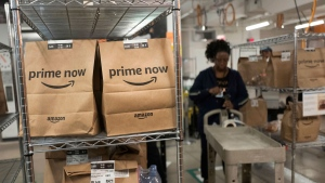 In this Dec. 20, 2017, photo, Prime Now customer orders are ready for delivery at the Amazon warehouse, in New York. (AP Photo/Mark Lennihan)