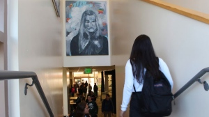 In this Tuesday, Jan. 30, 2018 photo provided by Sophia Muys, students pass under one of James Franco's paintings displayed above a stairwell in the Media Arts Center at Palo Alto High School in Palo Alto, Calif. (Sophia Muys/Paly Voice via AP)