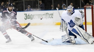 Toronto Maple Leafs goaltender Curtis McElhinney (35) tends the net against New York Rangers right wing Rick Nash (61) during the second period of an NHL hockey game, Thursday, Feb. 1, 2018, at Madison Square Garden in New York. (AP Photo/Mary Altaffer)