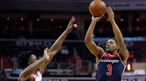 Washington Wizards guard Bradley Beal (3) shoots over Toronto Raptors forward OG Anunoby (3), from England, during the second half of an NBA basketball game Thursday, Feb. 1, 2018, in Washington. The Wizards won 122-119. (AP Photo/Alex Brandon)